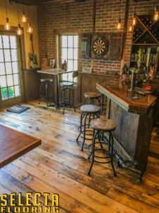 Bar area in Summit, New Jersey in Union County with wood floor and wood stools